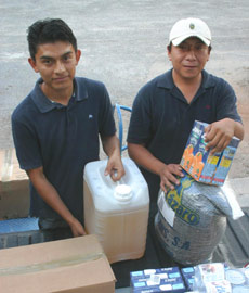 Juan and Luis delivering food and produces to the MFIL Nutrition Health Center at Xcalacoop