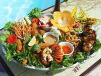 Fresh Seafood Platter perfectly grilled lobster tails, shrimps, deep fried calamari rings, crab, and other delights served with zesty Mexican sauces.