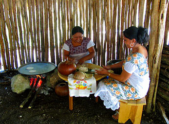 Manuela and Magali making tortillas - helping the Maya Children Nutrition Program